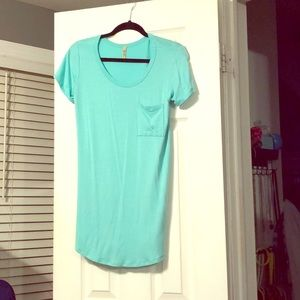 Bright teal tunic with pocket